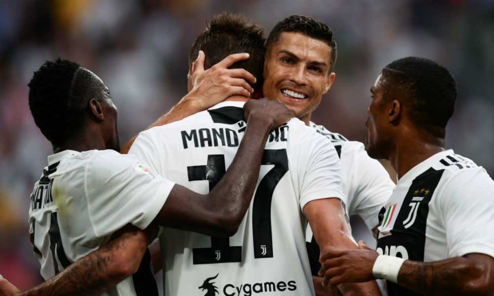 10-man Juve shares spoils with Roma in Serie A