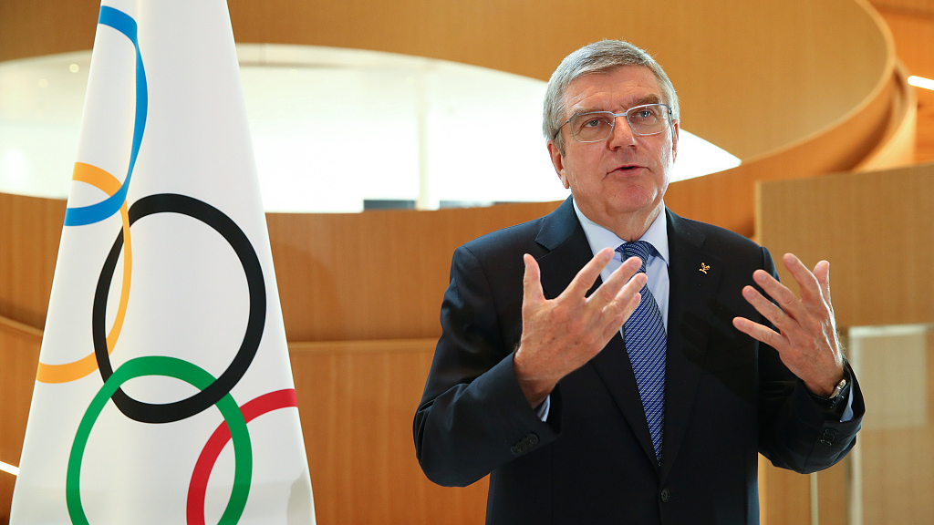 """Bach proposes adding """"together"""" to Olympic slogan"""
