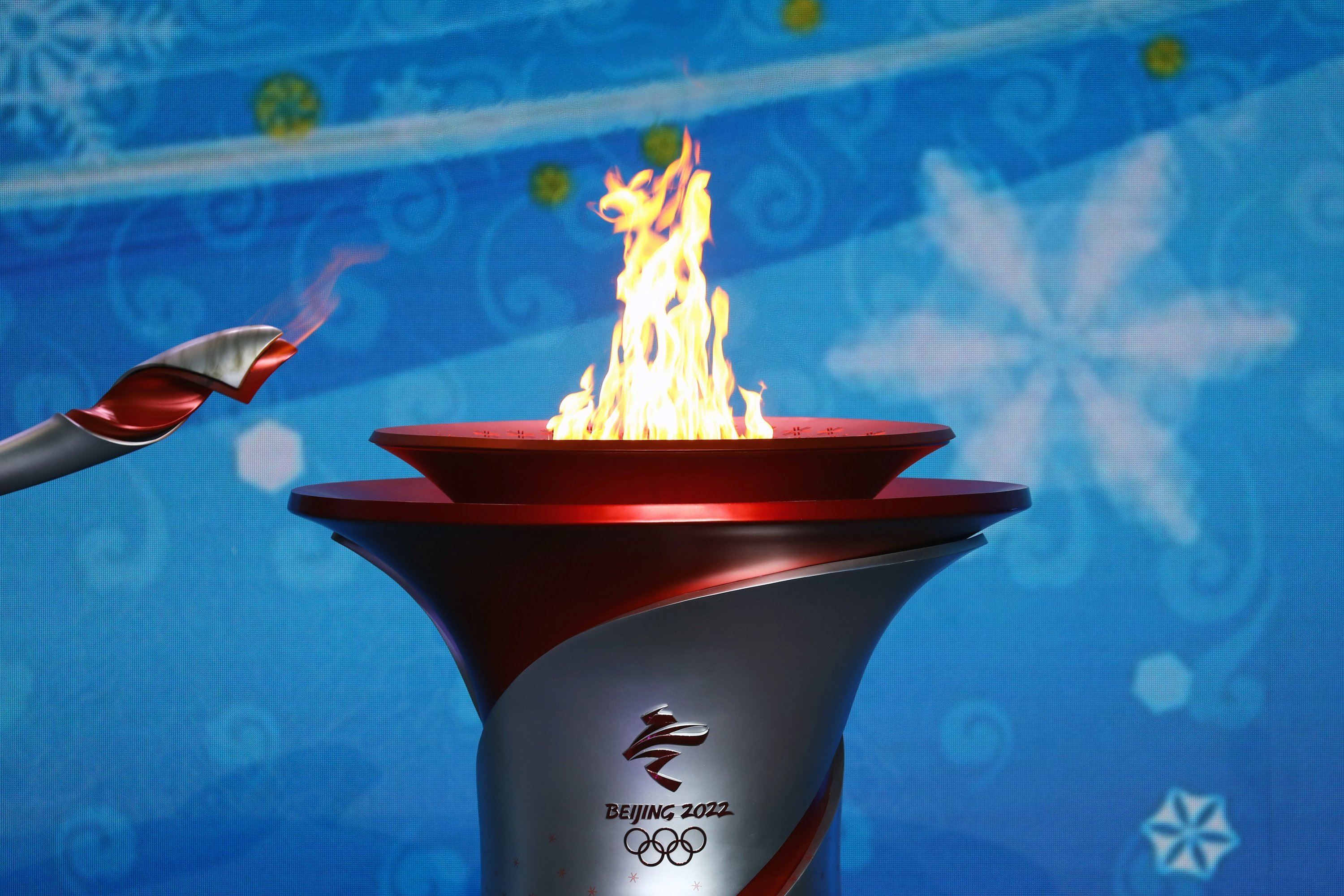 Beijing 2022 Winter Games: Olympic flame arrives in China